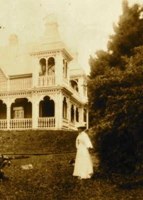 Woman standing on front lawn of Alberton
