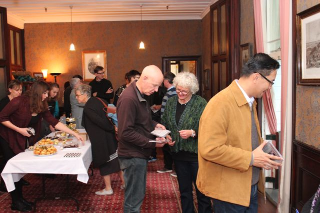 Guests inspecting CDs and afternoon tea